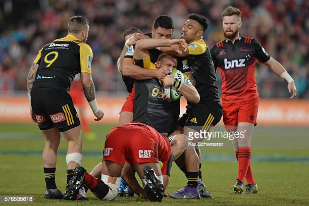 Brad Shields of the Hurricanes is tackled during the round 17 Super Rugby match between the Crusaders and the Hurricanes at AMI Stadium on July 16...