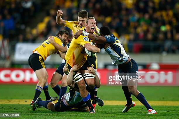 Brad Shields of the Hurricanes is tackled to the ground during the Super Rugby Semi Final match between the Hurricanes and the Brumbies at Westpac...