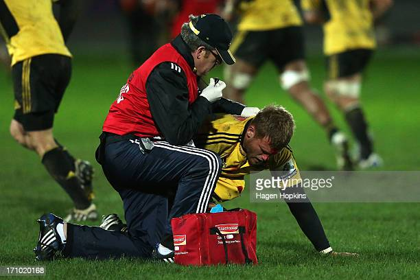 Brad Shields of the Hurricanes receives medical attention for a facial injury during the Super Rugby practice match between the Hurricanes and the...