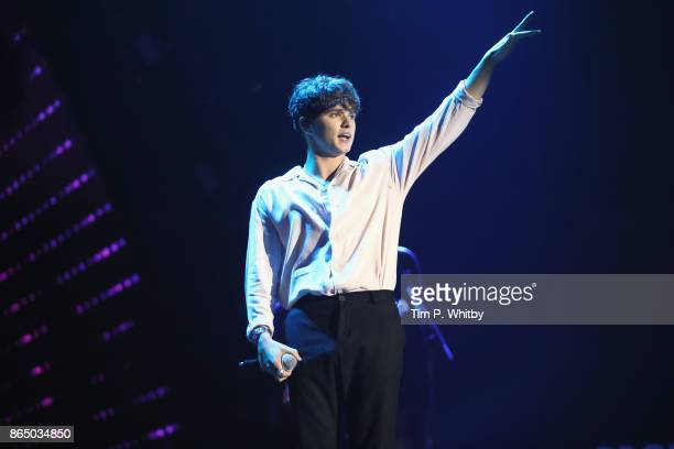 Brad Simpson performs on stage with The Vamps during the BBC Radio 1 Teen Awards 2017 at Wembley Arena on October 22 2017 in London England