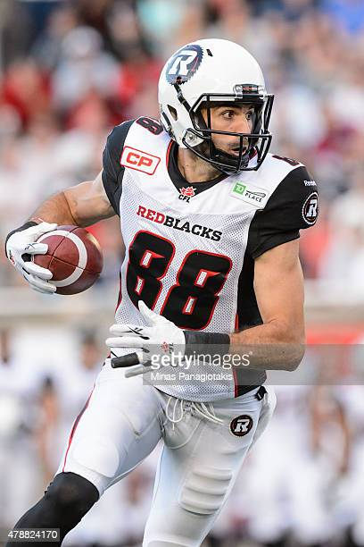 Brad Sinopoli of the Ottawa Redblacks runs with the ball during the CFL game against the Montreal Alouettes at Percival Molson Stadium on June 25...