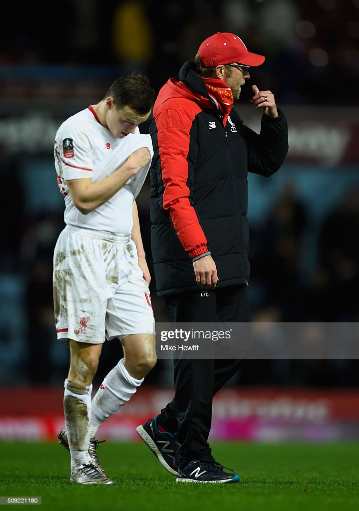 <a gi-track='captionPersonalityLinkClicked' href=/galleries/search?phrase=Brad+Smith+-+Futebolista&family=editorial&specificpeople=14051296 ng-click='$event.stopPropagation()'>Brad Smith</a> of Liverpool and Jurgen Klopp manager of Liverpool look dejected in defeat after the Emirates FA Cup Fourth Round Replay match between West Ham United and Liverpool at Boleyn Ground on February 9, 2016 in London, England.