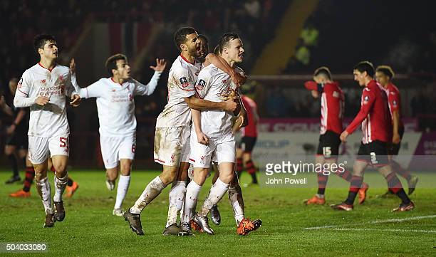 Brad Smith of Liverpool celebrates after scoring the second equalising goal during the Emirates FA Cup third round match between Exeter City and...