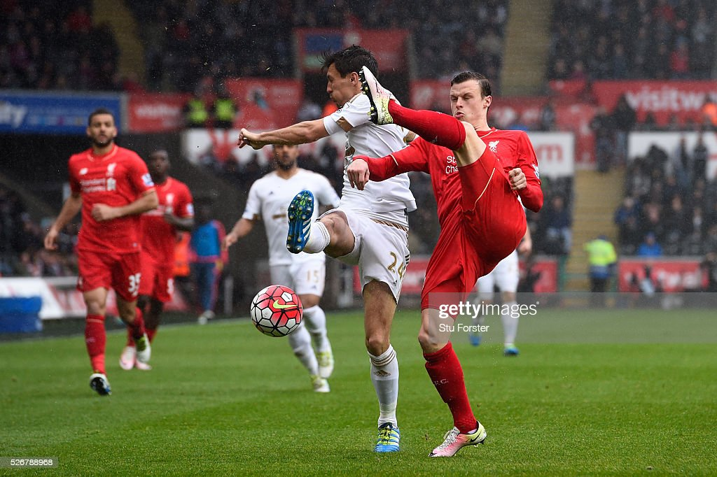 <a gi-track='captionPersonalityLinkClicked' href=/galleries/search?phrase=Brad+Smith+-+Soccer+Player&family=editorial&specificpeople=14051296 ng-click='$event.stopPropagation()'>Brad Smith</a> of Liverpool clears from <a gi-track='captionPersonalityLinkClicked' href=/galleries/search?phrase=Jack+Cork&family=editorial&specificpeople=4206991 ng-click='$event.stopPropagation()'>Jack Cork</a> of Swansea City during the Barclays Premier League match between Swansea City and Liverpool at The Liberty Stadium on May 1, 2016 in Swansea, Wales.