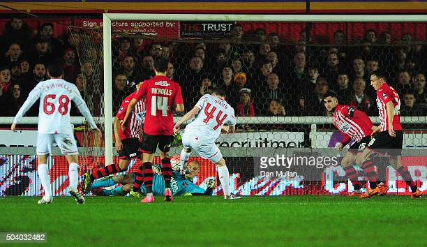 Brad Smith of Liverpool scores their second goal during the Emirates FA Cup third round match between Exeter City and Liverpool at St James Park on...