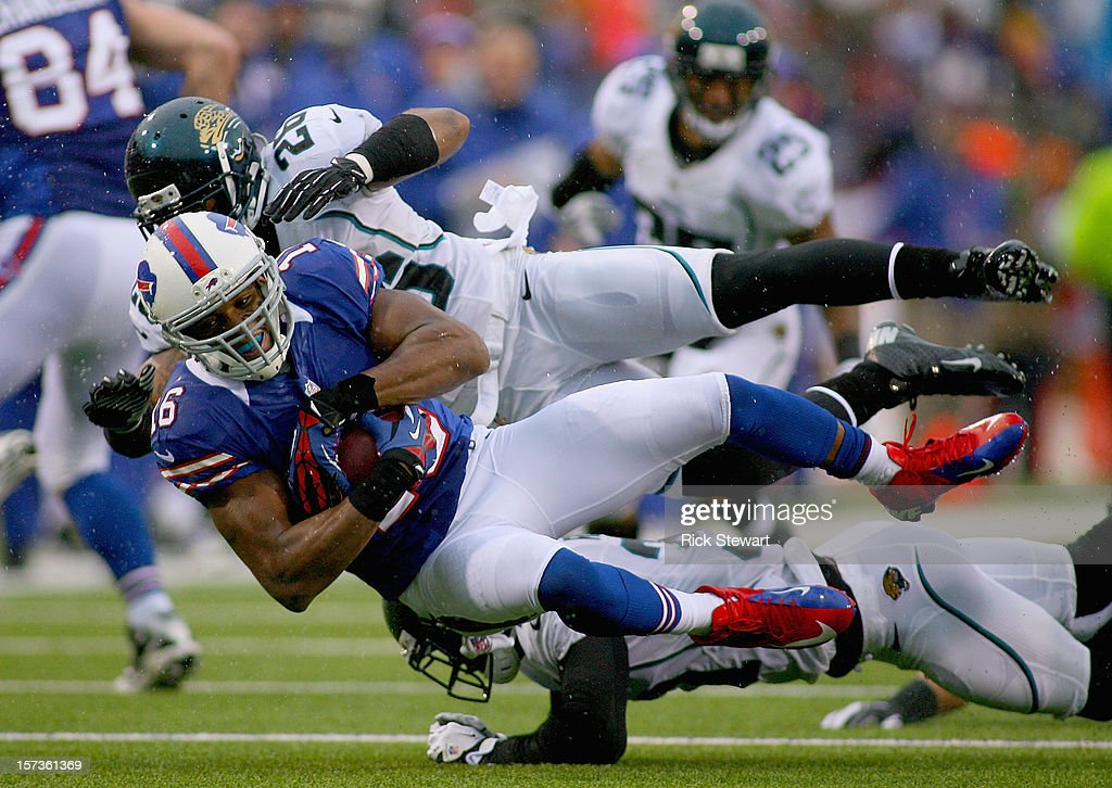 Brad Smith #16 of the Buffalo Bills is tackled by <a gi-track='captionPersonalityLinkClicked' href=/galleries/search?phrase=Dawan+Landry&family=editorial&specificpeople=575013 ng-click='$event.stopPropagation()'>Dawan Landry</a> #26 of the Jacksonville Jaguars at Ralph Wilson Stadium on December 2, 2012 in Orchard Park, New York. Buffalo won 34-18.