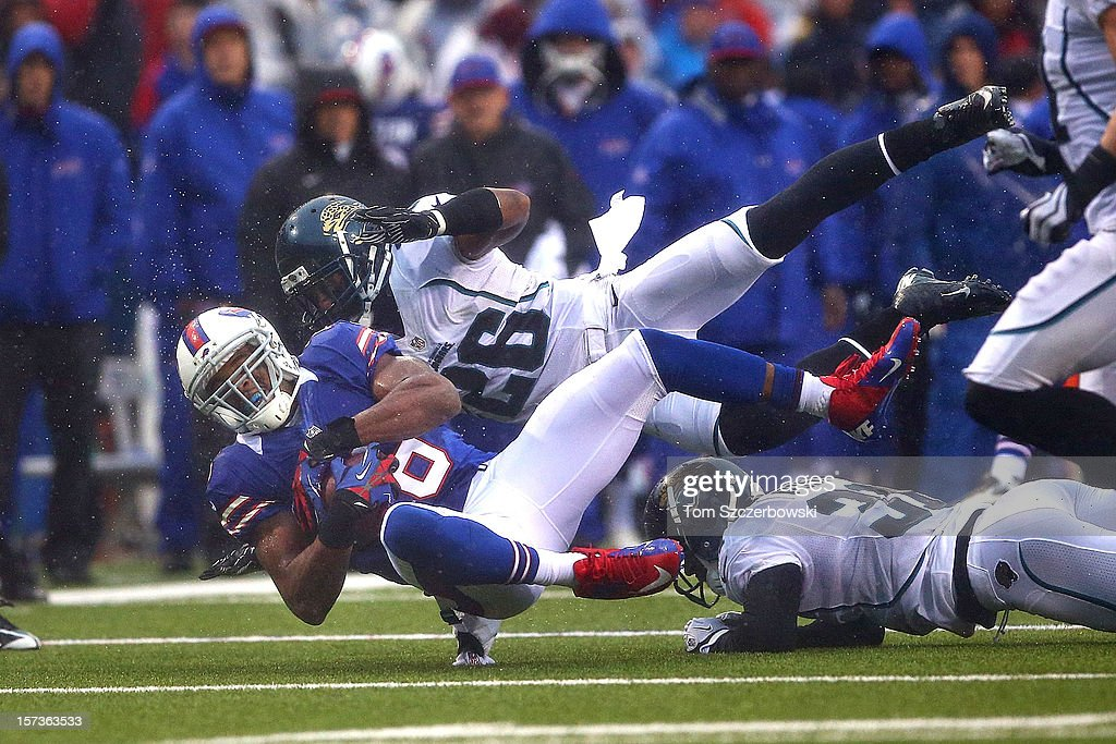 Brad Smith #16 of the Buffalo Bills is tackled during an NFL game by <a gi-track='captionPersonalityLinkClicked' href=/galleries/search?phrase=Dawan+Landry&family=editorial&specificpeople=575013 ng-click='$event.stopPropagation()'>Dawan Landry</a> #26 of the Jacksonville Jaguars at Ralph Wilson Stadium on December 2, 2012 in Orchard Park, New York.