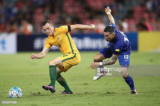 Brad Smith of the Socceroos and Tristan Do of Thailand compete for the ball the ball during the 2018 FIFA World Cup Qualifier match between Thailand...