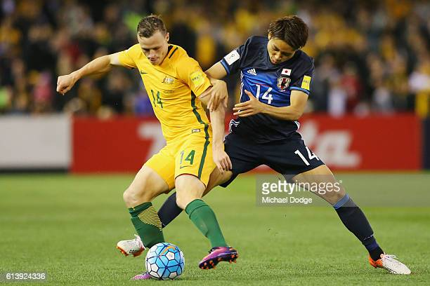 Brad Smith of the Socceroos and Yu Kobayashi of Japan compete for the ball during the 2018 FIFA World Cup Qualifier match between the Australian...