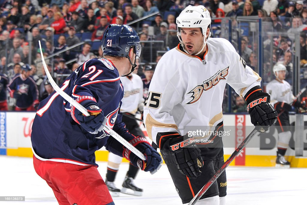 <a gi-track='captionPersonalityLinkClicked' href=/galleries/search?phrase=Brad+Staubitz&family=editorial&specificpeople=2221022 ng-click='$event.stopPropagation()'>Brad Staubitz</a> #25 of the Anaheim Ducks shares a few words after being hip-checked by <a gi-track='captionPersonalityLinkClicked' href=/galleries/search?phrase=James+Wisniewski&family=editorial&specificpeople=688111 ng-click='$event.stopPropagation()'>James Wisniewski</a> #21 of the Columbus Blue Jackets during the second period on March 31, 2013 at Nationwide Arena in Columbus, Ohio.