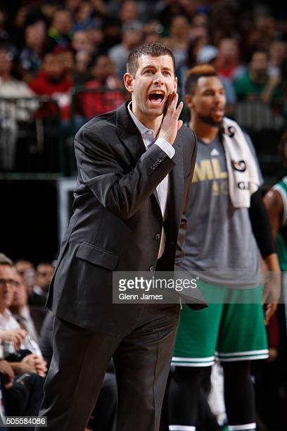 Brad Stevens head coach of the Boston Celtics calls out a play against the Dallas Mavericks on January 18 2016 at the American Airlines Center in...