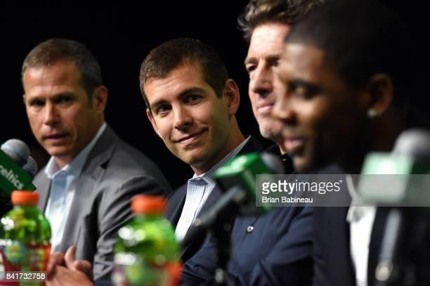 Brad Stevens looks on as Kyrie Irving and Gordon Hayward get introduced as Boston Celtics on September 1 2017 at the TD Garden in Boston...