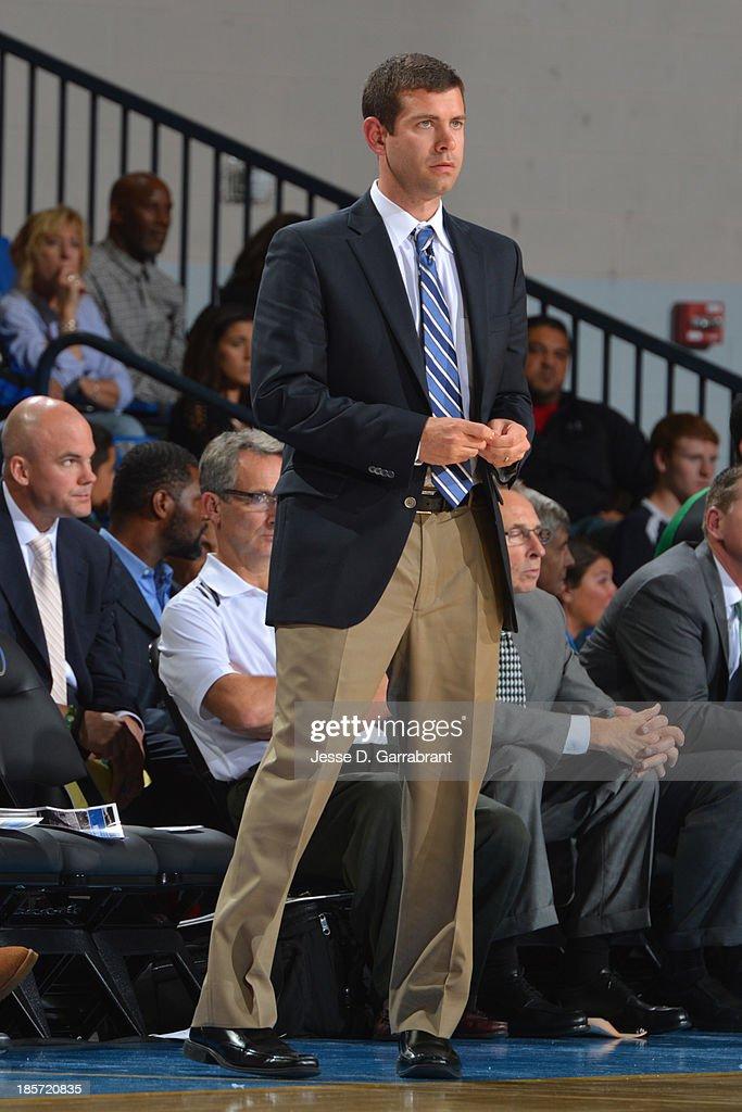 Brad Stevens of the Boston Celtics coaches against the Philadelphia 76ers at the Bob Carpenter Center on October 11, 2013 in Newark, Delaware.