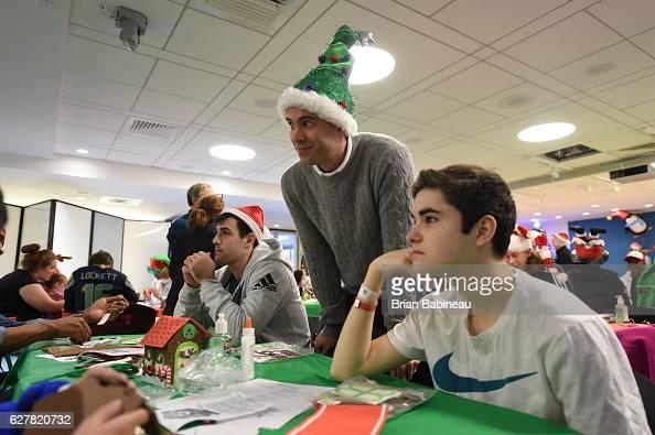 Brad Stevens of the Boston Celtics spreads holiday cheer duing a children's hospital visit on December 1 2016 at Boston Children's Hospital in Boston...