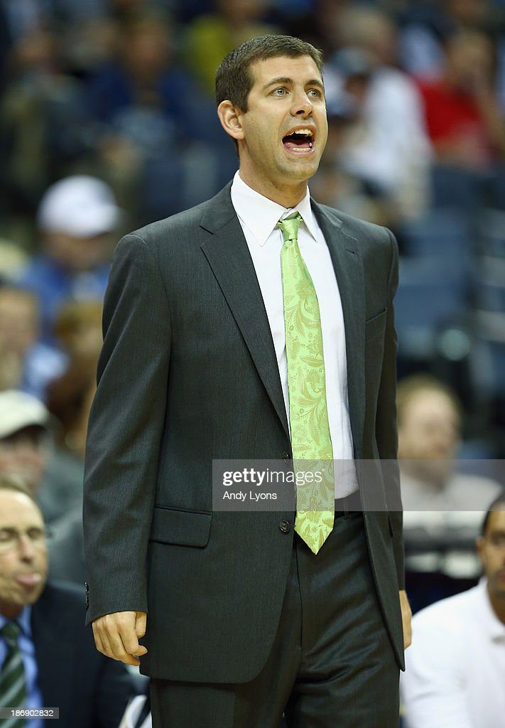 Brad Stevens the head coach of the Boston Celtics gives instructions to his team during the NBA game against the Memphis Grizzlies at FedExForum on November 4, 2013 in Memphis, Tennessee. The Grizzlies won 95-88.