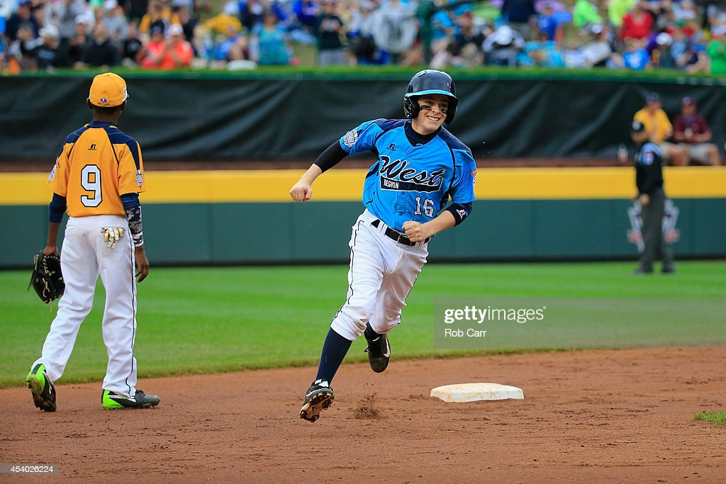Brad Stone #16 of the West Team from Las Vegas, Nevada rounds the bases after hitting a home run against the Great Lakes Team from Chicago, Illinois during the United States Championship game of the Little League World Series at Lamade Stadium on August 23, 2014 in South Williamsport, Pennsylvania.