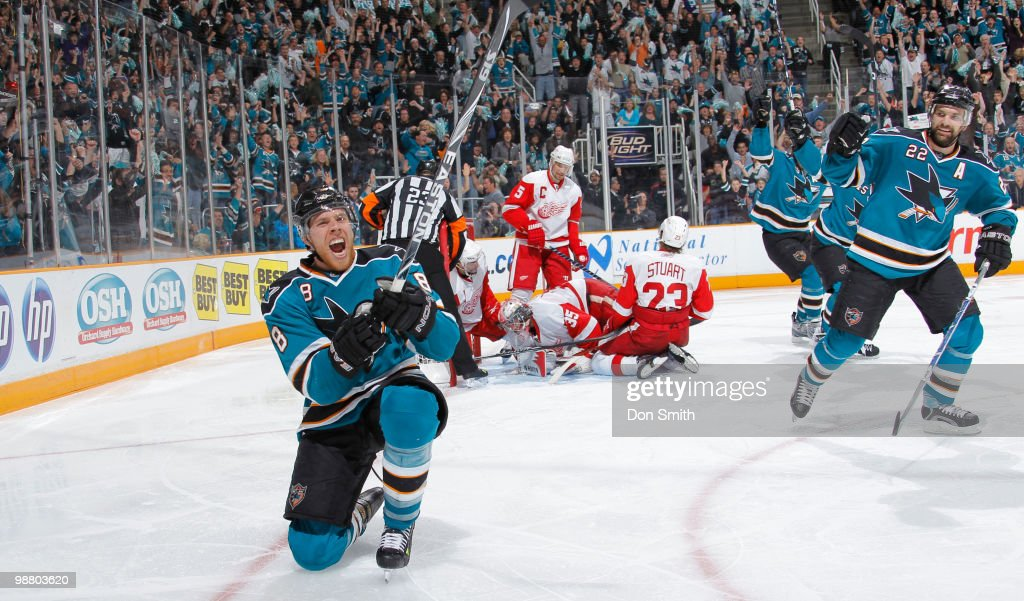 Brad Stuart #23, Jimmy Howard #35 and Nicklas Lidstrom #5 of the Detroit Red Wings and Dan Boyle #22 of the San Jose Sharks react to the game-tying goal by Joe Pavelski #8 of the San Jose Sharks in Game Two of the Western Conference Semifinals during the 2010 NHL Stanley Cup Playoffs on May 2, 2010 at HP Pavilion at San Jose in San Jose, California.