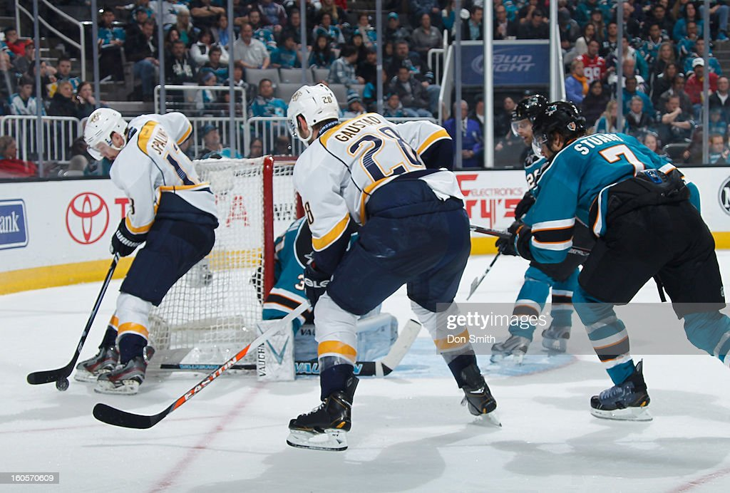 Brad Stuart #7, Michal Handzus #26 and Antti Niemi #31 of the San Jose Sharks protect the net against Nick Spaling #13 and Paul Gaustad #28 of the Nashville Predators during an NHL game on February 2, 2013 at HP Pavilion in San Jose, California.