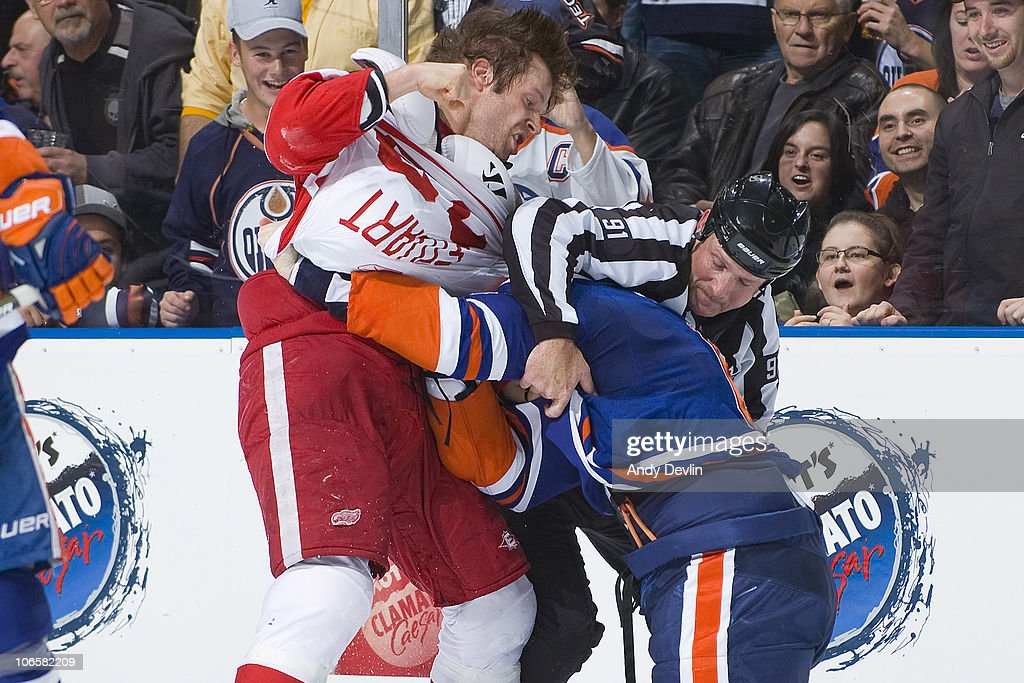Brad Stuart #23 of the Detroit Red Wings and Gilbert Brule #67 of the Edmonton Oilers drop the gloves during the second period at Rexall Place on November 5, 2010 in Edmonton, Alberta, Canada.