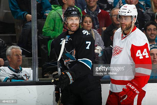 Brad Stuart of the San Jose Sharks skates against Todd Bertuzzi of the Detroit Red Wings at SAP Center on January 9 2014 in San Jose California