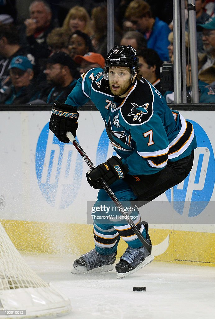Brad Stuart #7 of the San Jose Sharks skates with control of the puck against the Nashville Predators at HP Pavilion on February 2, 2013 in San Jose, California.