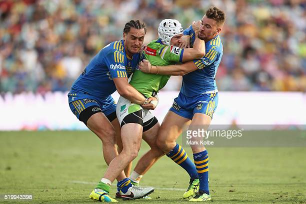 Brad Takairangi and Clint Gutherson of the Eels tackle Jarrod Croker of the Raiders during the round six NRL match between the Parramatta Eels and...