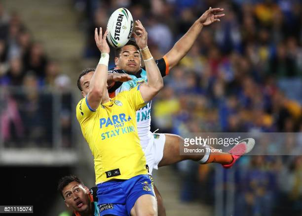 Brad Takairangi of the Eels competes with Esan Nike Marsters of the Tigers during the round 20 NRL match between the Wests Tigers and the Parramatta...