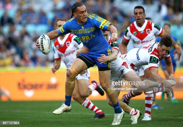 Brad Takairangi of the Eels looks to offload during the round 15 NRL match between the Parramatta Eels and the St George Illawarra Dragons at ANZ...