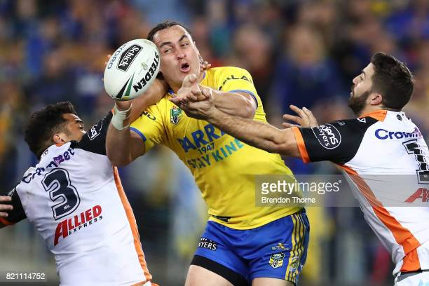 Brad Takairangi of the Eels passes the ball to a team mate during the round 20 NRL match between the Wests Tigers and the Parramatta Eels at ANZ...