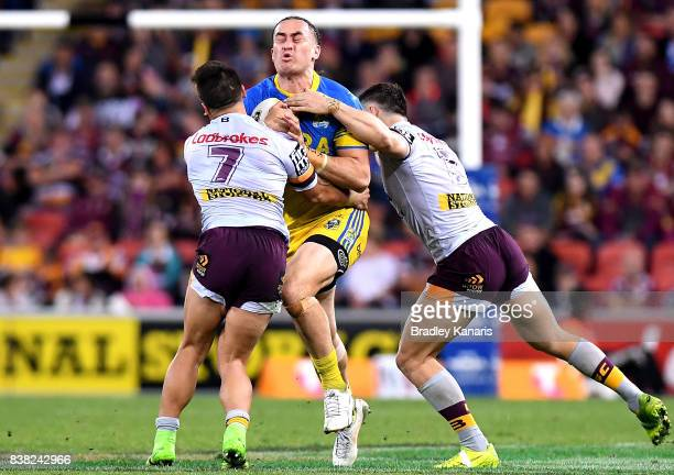 Brad Takairangi of the Eels takes on the defence during the round 25 NRL match between the Brisbane Broncos and the Parramatta Eels at Suncorp...