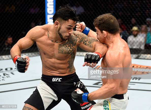 Brad Tavares lands an elbow to the chest of Caio Magalhaes of Brazil in their middleweight bout during the UFC 203 event at Quicken Loans Arena on...
