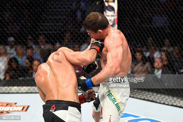 Brad Tavares punches Caio Magalhaes of Brazil in their middleweight bout during the UFC 203 event at Quicken Loans Arena on September 10 2016 in...