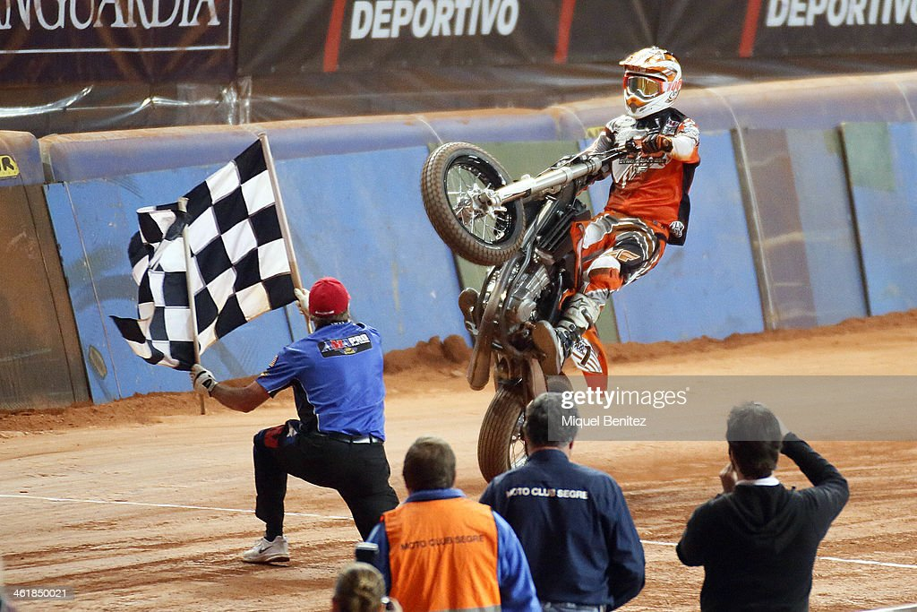 Brad 'The Bullet' Baker (R) arriving to the finish and Kevin 'The Falgman' Clark (L) during the Superprestigio Dirt Track Race at the Palau of Sant Jordi on January 11, 2014 in Barcelona, Spain.