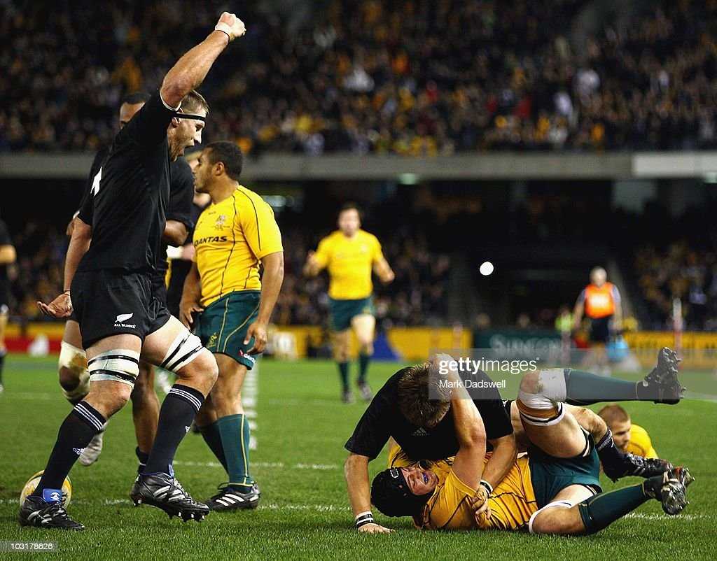 Brad Thorn celebrates a try by Richie McCaw of the All Blacks during the 2010 TriNations Bledisloe Cup match between the Australian Wallabies and the...