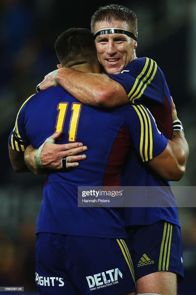 Brad Thorn celebrates with Hosea Gear of the Highlanders after winning the round 12 Super Rugby match between the Highlanders and the Sharks at...