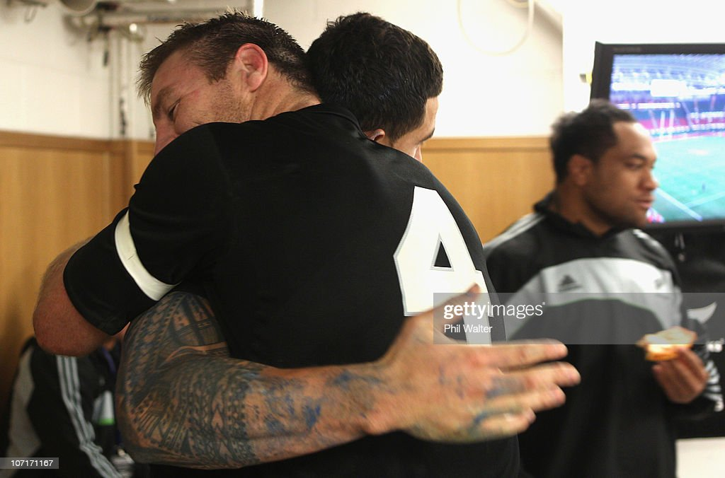 Brad Thorn (L) hugs Sonny Bill Williams in the dressing room following the Test match between Wales and the New Zealand All Blacks at Millennium Stadium on November 27, 2010 in Cardiff, Wales.