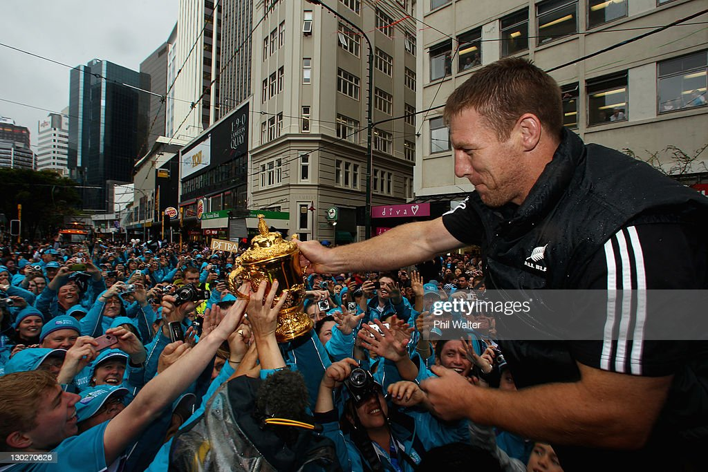 Brad Thorn of the All Blacks holds out the Webb Ellis Cup for the crowd during the New Zealand All Blacks 2011 IRB Rugby World Cup celebration parade...