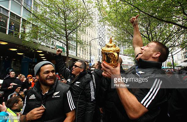 Brad Thorn of the All Blacks holds up the Webb Ellis Cup alongside Piri Weepu and Joe Locke during the New Zealand All Blacks 2011 IRB Rugby World...