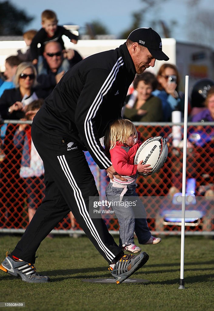 Brad Thorn of the All Blacks lifts a young supporter during a New Zealand All Blacks IRB Rugby World Cup 2011 fan day at Pioneer Recreation Sport...