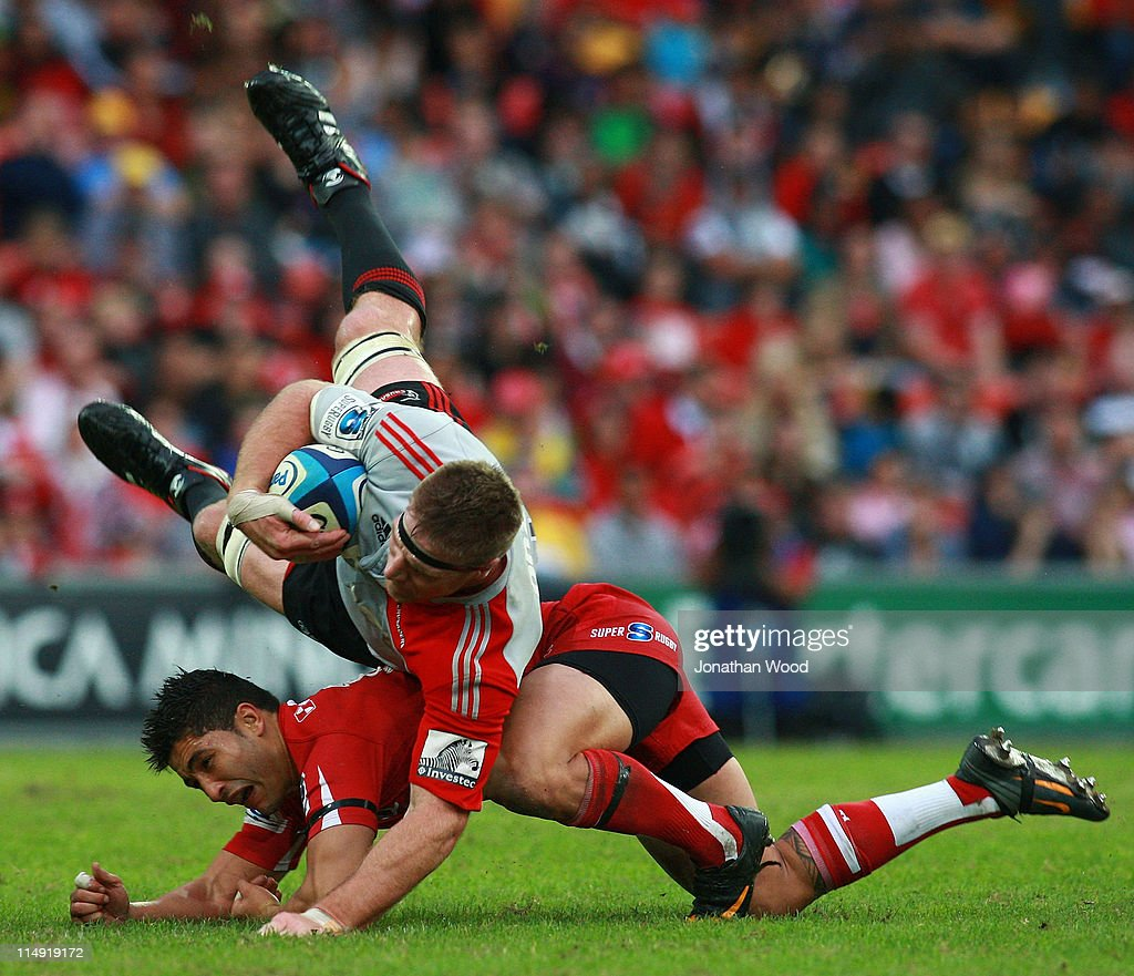 Brad Thorn of the Crusaders is hit in a tackle by Anthony Faingaa of the Reds during the round 15 Super Rugby match between the Reds and the...