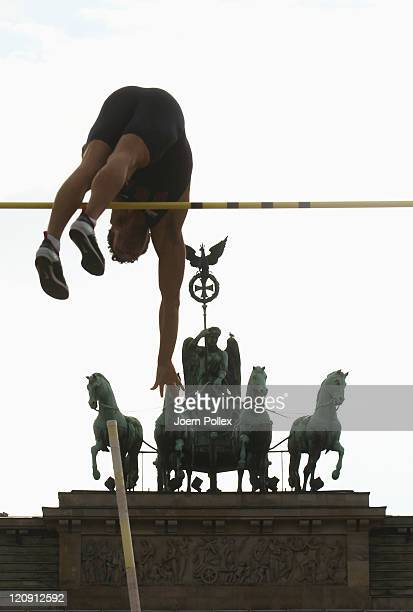Brad Walker of USA in action while competing in the Mens Pole Vault during the Air Show 'Berlin fliegt' at Brandenburger Tor on August 12 2011 in...