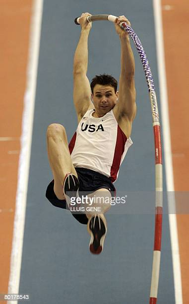 US Brad Walker takes part in the finals of the Men's Pole vault on March 9 2008 at the IAAF World Indoor Championships in Valencia Russia's Evgeniy...
