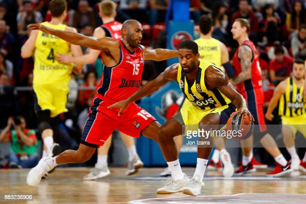 Brad Wanamaker #11 of Fenerbahce Dogus Istanbul competes with Jayson Granger #15 of Baskonia Vitoria Gasteiz during the 2017/2018 Turkish Airlines...