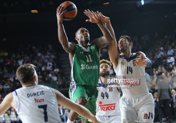 Brad Wanamaker of Darussafaka Dogus in action against Gustavo Ayon of Real Madrid during the Turkish Airlines EuroLeague Playoffs Game 4 between...