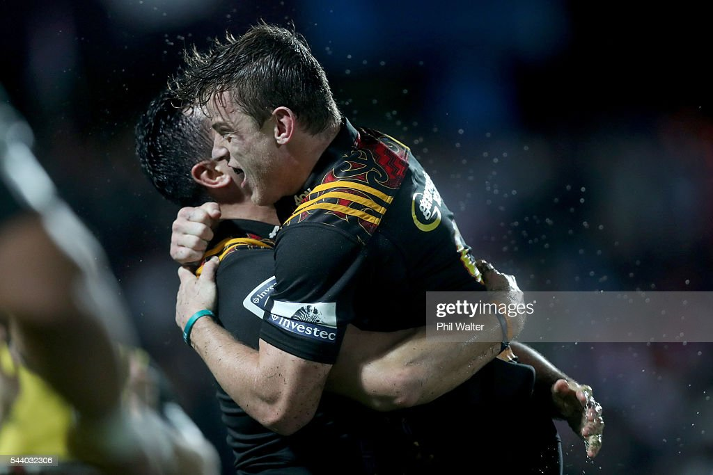 Brad Weber of the Chiefs congratulates James Lowe on his try during the round 15 Super Rugby match between the Chiefs and the Crusaders at ANZ Stadium on July 1, 2016 in Suva, Fiji.