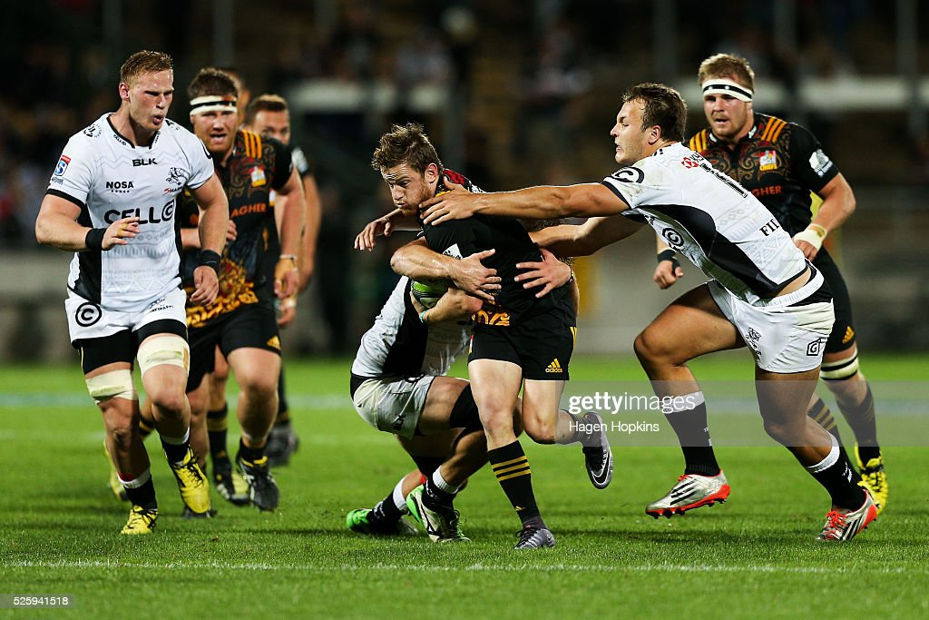 Brad Weber of the Chiefs is tackled during the round 10 Super Rugby match between the Chiefs and the Sharks at Yarrow Stadium on April 29, 2016 in New Plymouth, New Zealand.