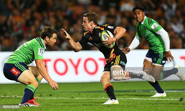 Brad Weber of the Chiefs looks to beat the tackle of Ben Smith of the Highlanders during the round four Super Rugby match between the Chiefs and the...