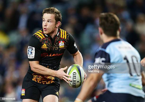 Brad Weber of the Chiefs runs with the ball during the round 14 Super Rugby match between the Waratahs and the Chiefs at Allianz Stadium on May 27...