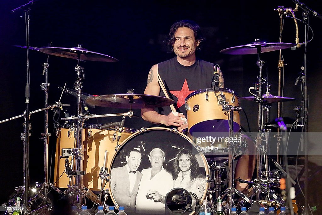 <a gi-track='captionPersonalityLinkClicked' href=/galleries/search?phrase=Brad+Wilk&family=editorial&specificpeople=2131354 ng-click='$event.stopPropagation()'>Brad Wilk</a> performs in concert at the Sound City showcase at Stubbs BBQ during the South By Southwest Music Festival on March 14, 2013 in Austin, Texas.