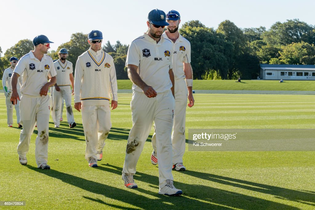 Brad Wilson of Otago (C) and his teammates walk from the ground during the Plunket Shield match between Canterbury and Otago on March 15, 2017 in Christchurch, New Zealand.
